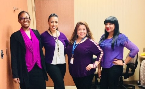 VA employees at the VA outpatient clinic in Laredo, Texas, pose for a group photo on October 10, 2018, while wearing different purple garments in order to help support the VA's national observance of Domestic Violence Awareness Month. Domestic violence is sometimes referred to as Intimate Partner Violence (IPV). The VA is committed to helping Veterans, their families and VA employees who experience IPV. (Photo courtesy of Crystal Cabido)