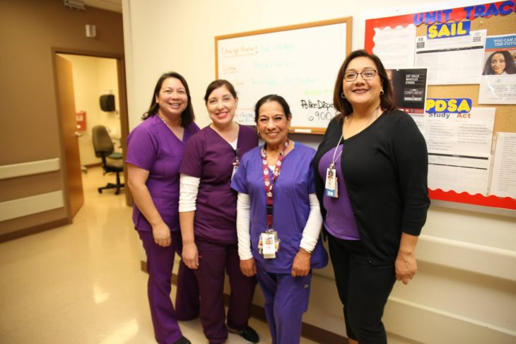 VA nurses pose for a group photo with purple garments on October 10, 2018, at the VA Health Care Center at Harlingen,Texas, in observance of this year's Domestic Violence Awareness Month. (U.S. Department of Veterans Affairs photo by Luis H. Loza Gutierrez)