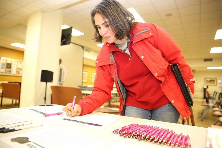 Former soldier, Maricela Alvarado, registers during the Women Veterans Town Hall held November 14, 2018, at the VA Health Care Center at Harlingen, Texas. Alvarado was one of dozen Women Veterans who attended the hour-long free public event.