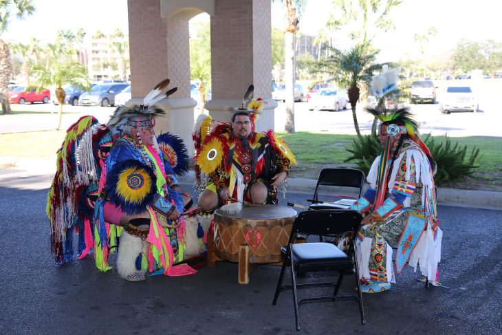 Member of the Lipan Apache Tribe of Texas perform by playing and singing inside a drum circle during a special event in observance of National Native American Heritage Month, which took place at the VA outpatient clinic in Harlingen, Texas, on November 16, 2018. (U.S. Department of Veterans Affairs photo by Luis H. Loza Gutierrez)