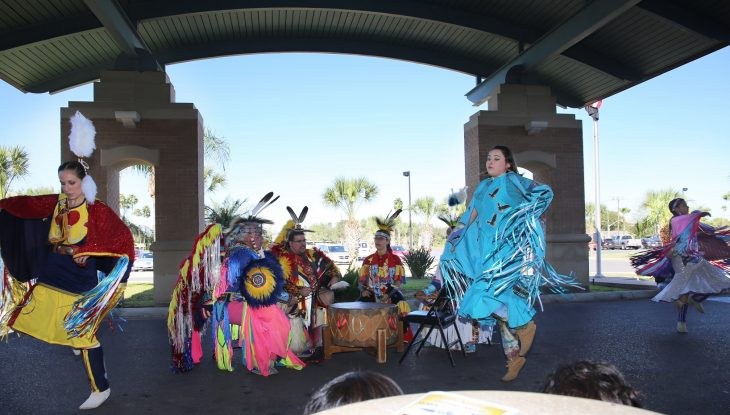 Members of the Lipan Apache Tribe of Texas perform by singing and dancing to a crowd of approximately 100 spectators during a special event held in observance of National Native American Heritage Month, which took place at the VA outpatient clinic in Harlingen, Texas, on November 16, 2018. (U.S. Department of Veterans Affairs photo by Luis H. Loza Gutierrez)