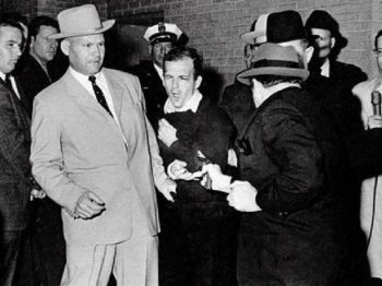 IMAGE: Lee Harvey Oswald, suspected assassin of President John F. Kennedy, grimaces as he is shot to death at point-blank range by nightclub owner Jack Ruby in the basement of the Dallas police headquarters Nov. 24, 1963. Plainclothes officer at left is Jim Leavelle. Photo by Bob Jackson