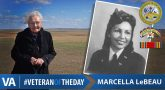 graphic shows Veteran Marcella LeBeau standing in a field. Text reads: VA - #VETERANOFTHEDAY - Marcella LeBeau