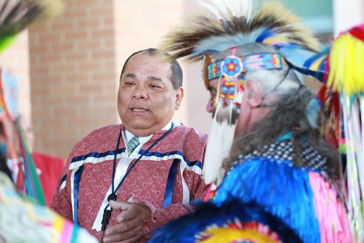 (At center) Master of ceremony, Gregorio Kishketon, co-event coordinator and a member of the Kickapoo Tribe of Oklahoma welcomes members of the Lipan Apache Tribe of Texas before the start of a special event held in observance of National Native American Heritage Month, which took place at the VA outpatient clinic in Harlingen, Texas, on November 16, 2018. (U.S. Department of Veterans Affairs photo by Reynaldo Leal)