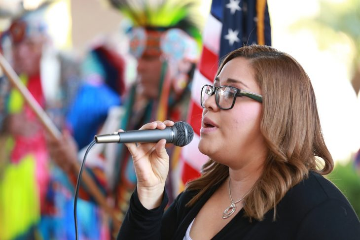 Jo Gonzalez, sings the Star Spangled Banner during a special event held in observance of National Native American Heritage Month, which took place at the VA outpatient clinic in Harlingen, Texas, on November 16, 2018. The crowd of nearly 100 people cheered and applauded Gonzalez for the terrific rendition of the U.S. national anthem. (U.S. Department of Veterans Affairs photo by Reynaldo Leal)