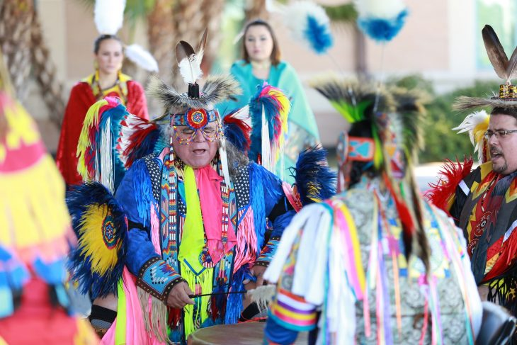 Members of the Lipan Apache Tribe of Texas perform a song from inside a drum circle during a special event held in observance of National Native American Heritage Month, which took place at the VA outpatient clinic in Harlingen, Texas, on November 16, 2018. (U.S. Department of Veterans Affairs photo by Reynaldo Leal)