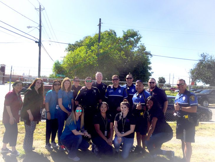 Members of the Corpus Christi Police Department (CCPD) and staff members from VA Texas Valley Coastal Bend Health Care System pose for a group photo during the Corpus Christi Stand Down, which took place November 2, 2018, in downtown Corpus Christi, Texas. CCPD worked to identify Veterans experiencing homelessness and connect them with VA services.(Photo courtesy of Jennifer Suarez)
