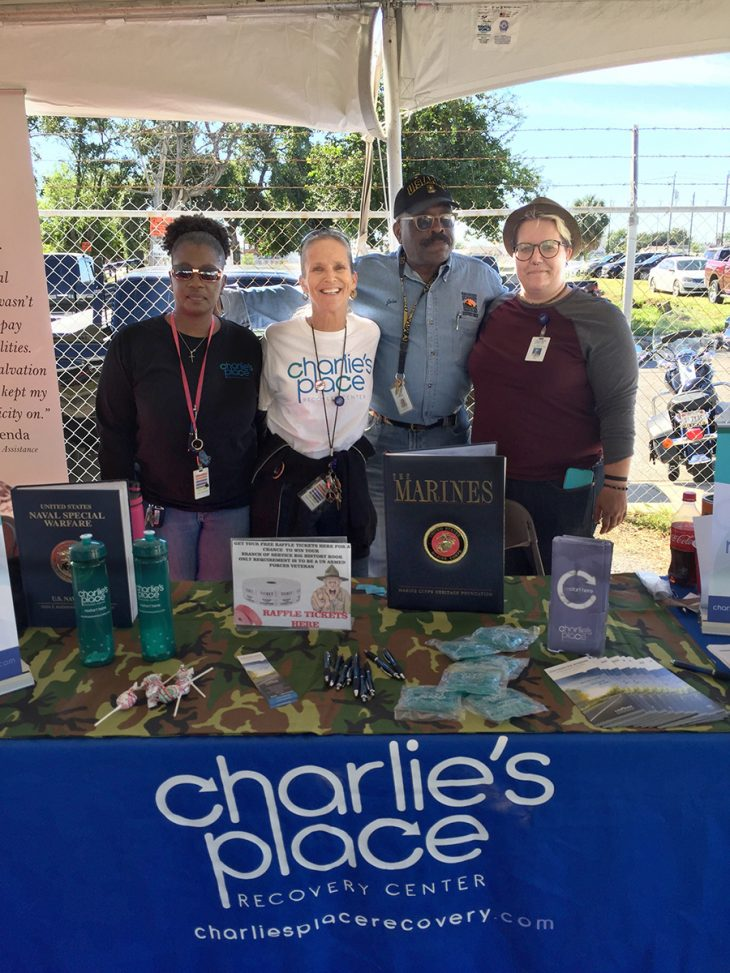 Charlie's Place Recovery Center recovery coaches Keisha Smith, John Watson, Eli Poore, and Patty Doty a recovery support services supervisor, pose for a group photo during the Corpus Christi Stand Down, which took place November 2, 2018, in downtown Corpus Christi, Texas. The group was one of several organizations that took part in the event designed to provide assistance to homeless Veterans. (Photo by Carrie Myers)