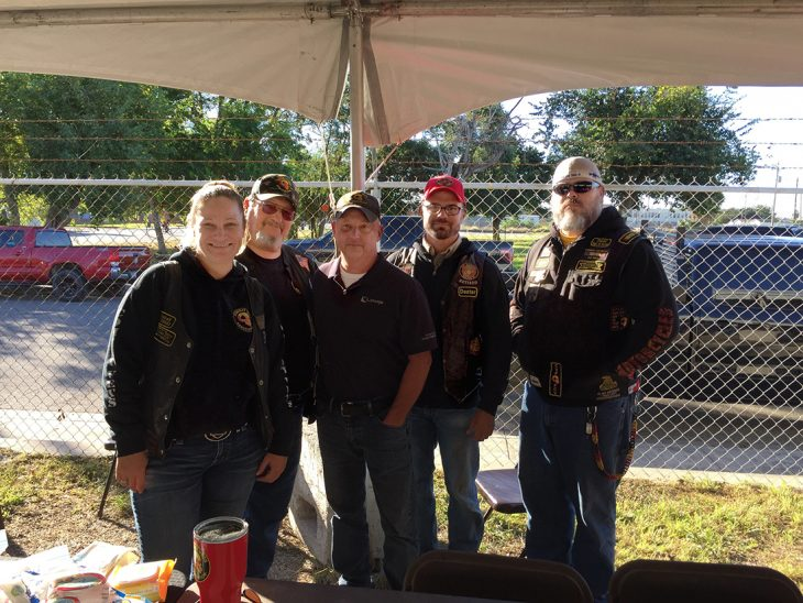 Combat Veteran Motorcycle Association members pose for a group photo during the Corpus Christi Stand Down, which took place November 2, 2018, in downtown Corpus Christi, Texas.  The group was one of several organizations that took part in the event designed to provide assistance to homeless Veterans. (Photo by Carrie Myers)