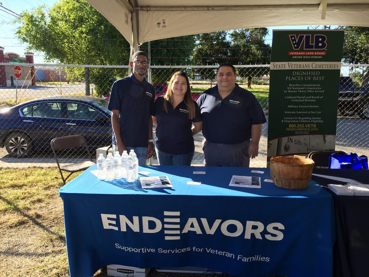 Endeavors's outreach and intake specialist, Sheroid Lucas and Mona Vasquez along with Hector Revilla, case manager, pose for a group photo during the Corpus Christi Stand Down, which took place November 2, 2018, in downtown Corpus Christi, Texas. The group was one of several organizations that took part in the event designed to provide assistance to homeless Veterans. (Photo by Carrie Myers)