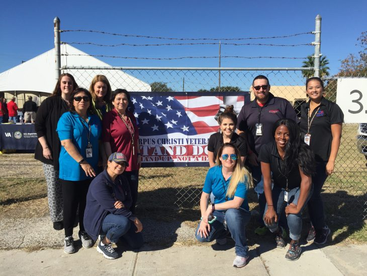 VA Homeless Program Team members Melinda Rosson, Alison Horton, Doris Alvarez, Rosa Balderas, Andrea Middagh, Chris King, Kim Orona, Lynne Hall, Jenesis Shaw, and Carrie Myers pose for a group photo during the Corpus Christi Stand Down, which took place November 2, 2018, in downtown Corpus Christi, Texas. The group was one of several organizations that took part in the event designed to provide assistance to homeless Veterans. (Photo by Jennifer Suarez)