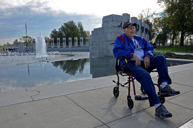 Man in wheelchair at WWII Monument
