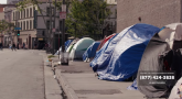 Image: tents set up on a side walk