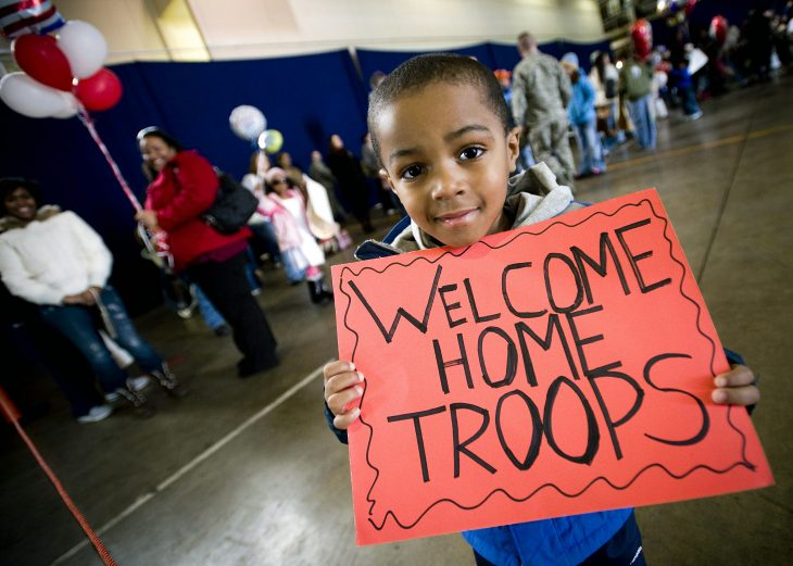 Child welcomes home US Military troops at the airport