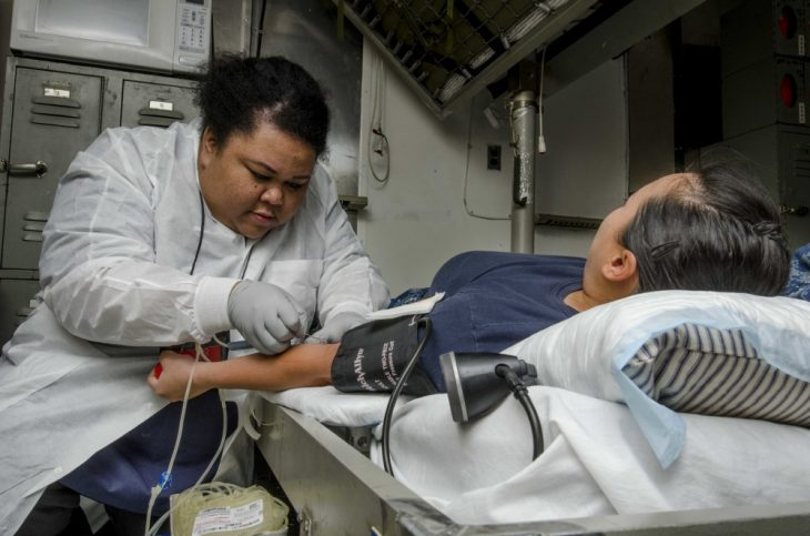 Nurse drawing blood from patient
