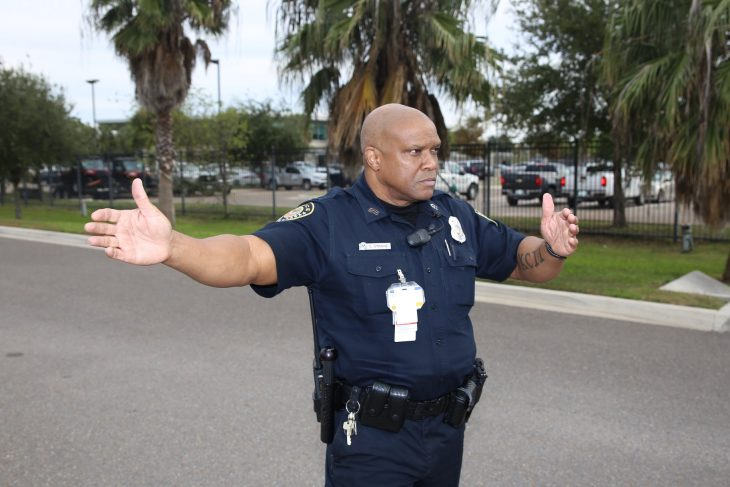 VA police Sgt. Charlton Stroud directs vehicles during the Free Produce Distribution Drive-thru held December 12, 2018, at the parking lot of the VA outpatient clinic at McAllen, Texas. Stroud and his fellow officers ensured traffic flowed smoothly through the parking lot and produce distribution point. This year's event marks the second time an event of this kind has taken place. Overall, a total of 273 families consisting of 607 adults and 226 children (from military families) received more than 10,100 pounds of nutritional fruits and vegetables. (U.S. Department of Veterans Affairs photo by Luis H. Loza Gutierrez)