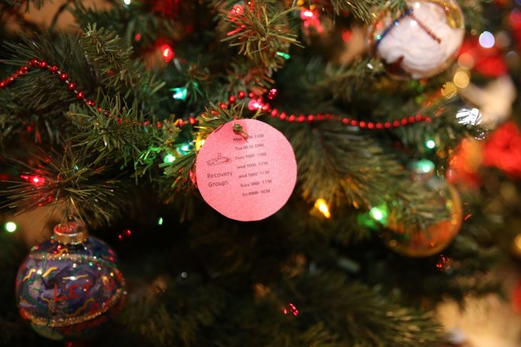 A paper ornament listing the times and dates of the Peer Support Groups at the VA Health Care Center at Harlingen, Texas, hangs from the branch of a second Recovery Holiday Tree with ornaments made by VA staff members and Veterans was put on display as part of the Christmas Tree Forest Exhibit at the Brownsville Historical Association's heritage museum.  Photo taken December 28, 2018. (U.S. Department of Veterans Affairs photo by Luis H. Loza Gutierrez)