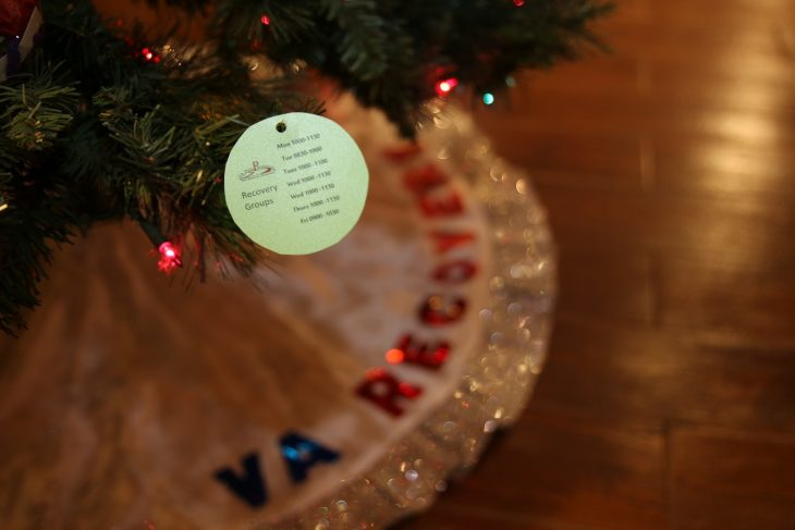 A paper ornament listing the times and dates of the Peer Support Groups at the VA Health Care Center at Harlingen, Texas, hangs from the branch of a second Recovery Holiday Tree with ornaments made by VA staff members and Veterans was put on display as part of the Christmas Tree Forest Exhibit at the Brownsville Historical Association located inside the heritage museum on December 28, 2018. The museum is located at 1325 East Washington Street, in Brownsville, Texas. The tree will be on display at the exhibit till January 5, 2019. (U.S. Department of Veterans Affairs photo by Luis H. Loza Gutierrez)