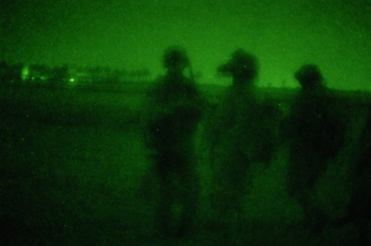 Night vision photo of three Army soldiers' silhouettes