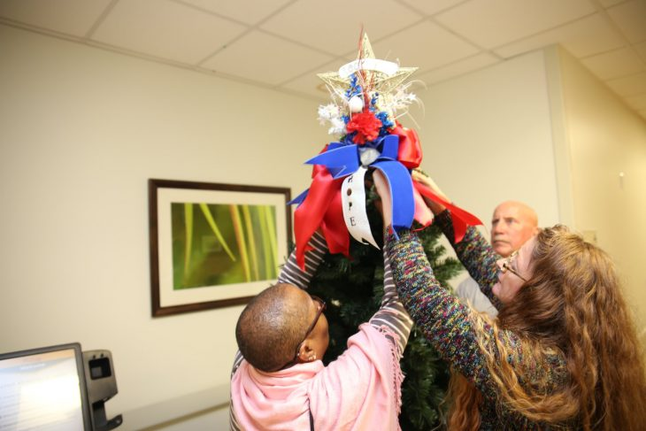 VA staff members and Veterans decorate a recovery tree on December 11, 2018, at the VA Health Care Center at Harlingen, Texas. (U.S. Department of Veterans Affairs photo by Luis H. Loza Gutierrez)