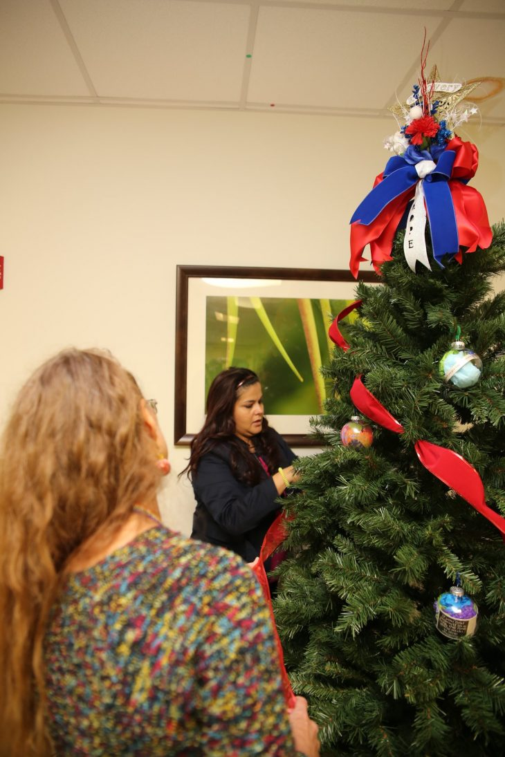 VA staff members Blanca Benavides, and Cilly Jordan decorate a recovery holiday tree on December 11, 2018, at the VA Health Care Center at Harlingen, Texas. (U.S. Department of Veterans Affairs photo by Luis H. Loza Gutierrez)
