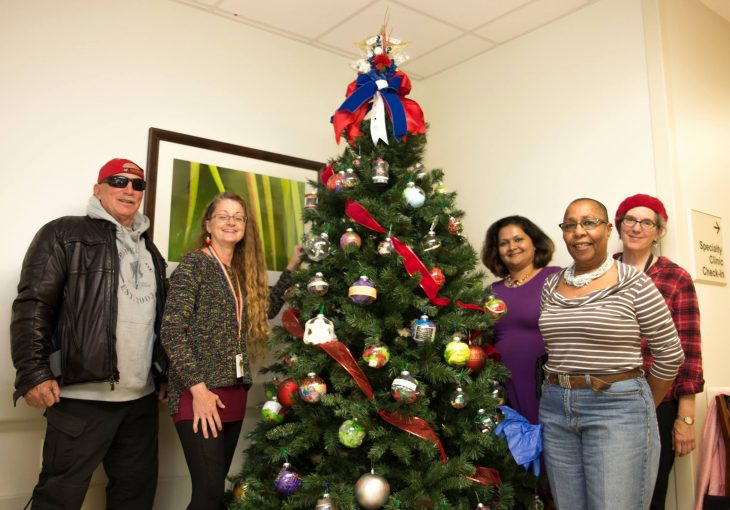VA staff members and Veterans pose for a group photo after decorating a recovery tree on December 11, 2018, at the VA Health Care Center at Harlingen, Texas. (U.S. Department of Veterans Affairs photo by Luis H. Loza Gutierrez)