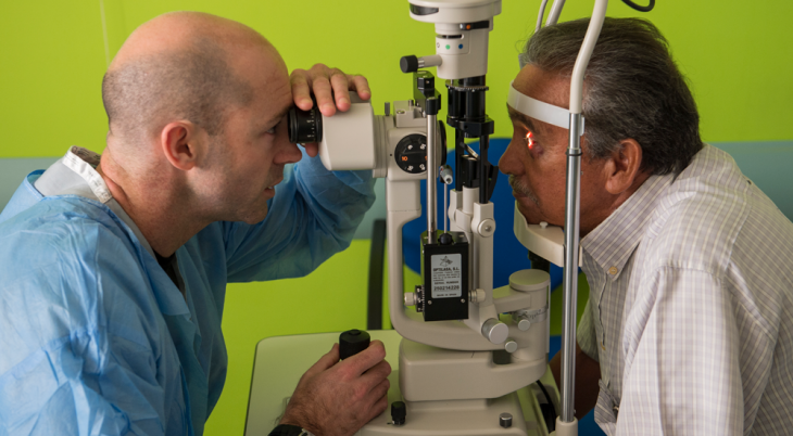 Doctor giving man eye test