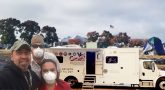 Composition photo showing Chico Vet Center Staff, a mobile vet center truck, and tents from the Camp Fire
