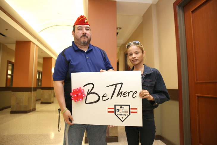 As gesture for solidarity and care for military Veterans and their families U.S. Marine Corps Veteran Jorge Vallejo and his wife Rose pose for photo using a poster with the #BeThere campaign hashtag and the Veterans Crisis Line Challenge logo in order to help raise awareness about suicide prevention on January 23, 2019, at the VA outpatient clinic in Harlingen, Texas. The Be There campaign is a VA initiative that urges communities to support at-risk Veterans through simple actions' (U.S. Department of Veterans Affairs photo by Luis H. Loza Gutierrez)