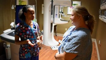 IMAGE: Marlo Trabue, Radiologic Technologist at VA North Texas, answers question from U.S. Navy Veteran Kathy Lowery, during her appointment in the mammography imaging suite.
