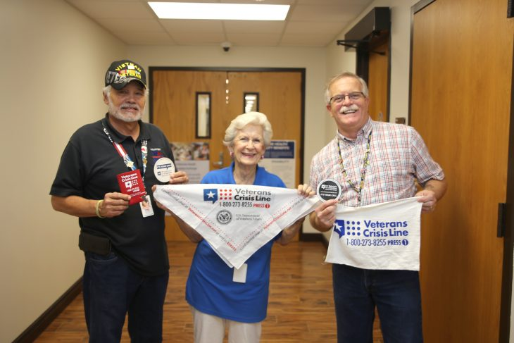 VA volunteers Arnulfo Martinez and LaVerne Shrader pose with VA Voluntary Service specialist Gary Burger while holding items promoting the Veterans Crisis Line number and logo in order to help raise awareness for suicide prevention on January 16, 2019, at the VA outpatient clinic in Corpus Christi, Texas. (U.S. Department of Veterans Affairs photo by Luis H. Loza Gutierrez)