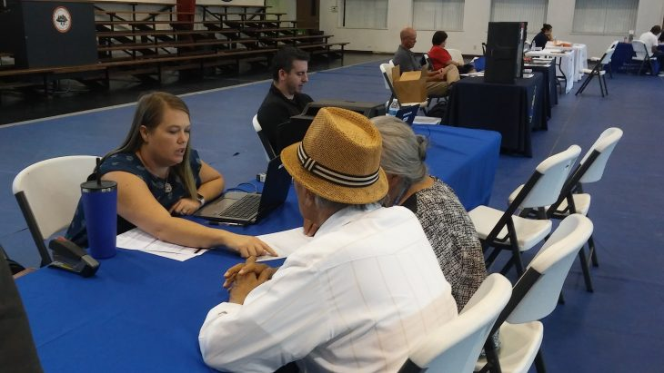 IMAGE: VA employee talks to tribal Veterans during event