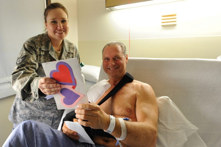 U.S. Air Force Staff Sgt. Rebecca Graffius, Supply Specialist, 4th Combat Camera Squadron, March Air Reserve Base, Calif., gives a Valentine's card to U.S. Army Sgt. Lance Alford, a Vietnam era veteran at Loma Linda Veterans Hospital, Loma Linda, Calif., Feb. 16, 2011. (U.S. Air Force photo by Tech. Sgt. Christine Jones/Released)