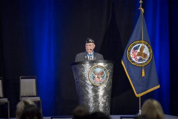 "Herschel ""Woody"" Williams, Medal of Honor Recipient addresses crowd at the VA PX Symposium."