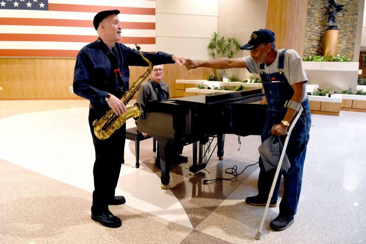 A veteran thanks a musician with Texas Winds for playing