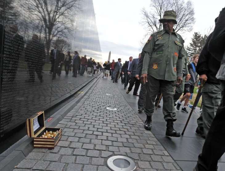 IMAGE of Veteran walking by Vietnam War Memorial