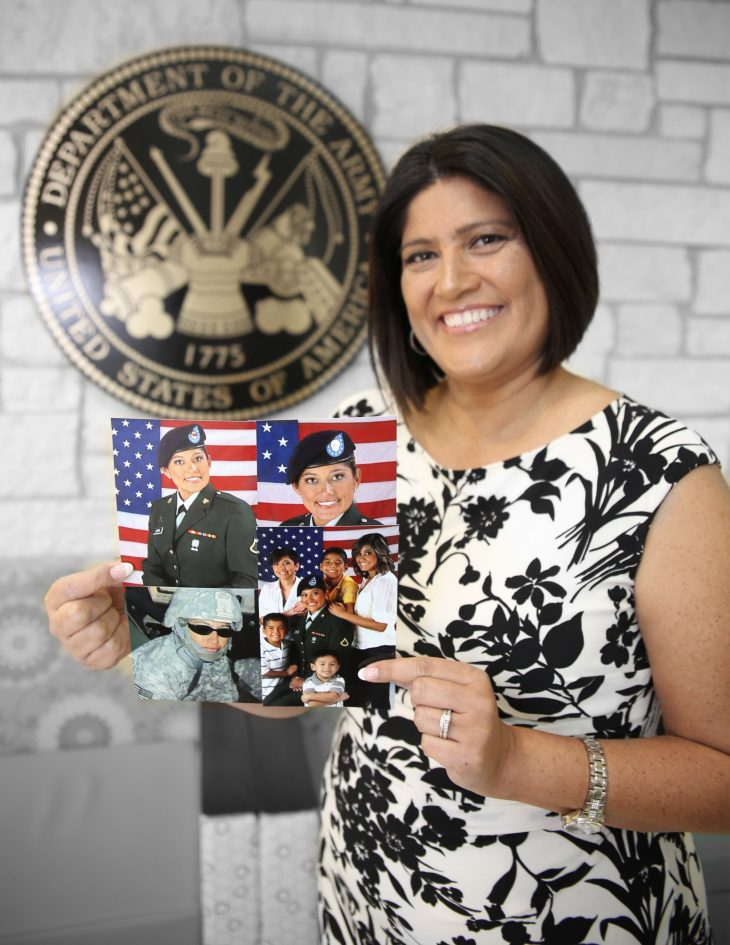 With a collage of photos of herself in military uniform, her family in her hands, American military Veteran Ann Marie Torres poses for a portrait in front of the seal of the U.S. Army located inside the main lobby of the VA's specialty clinic in Corpus Christi, Texas, on February 22, 2019.  Torres was one of 22 women Veterans from the Corpus Christi area who participated in VA Texas Valley Coastal Bend Health Care System's (VCB) 2019 Women Veteran's Portrait Project, which is designed to recognize the service of Women Veterans from the local community during Women's History Month, a nation-wide observance that takes place in March. Torres is a war Veteran of Operation Iraqi Freedom and was deployed to Baghdad from 2009 to 2010. The image located in the lower left corner of the collage shows a photo of the former Soldier wearing a helmet while deployed. Torres served in the Army from October 2008 to December 2018. During her enlistment she achieved the rank of corporal and worked as an automated logistical specialist and a cargo specialist.  (VA photo illustration by Luis H. Loza Gutierrez)