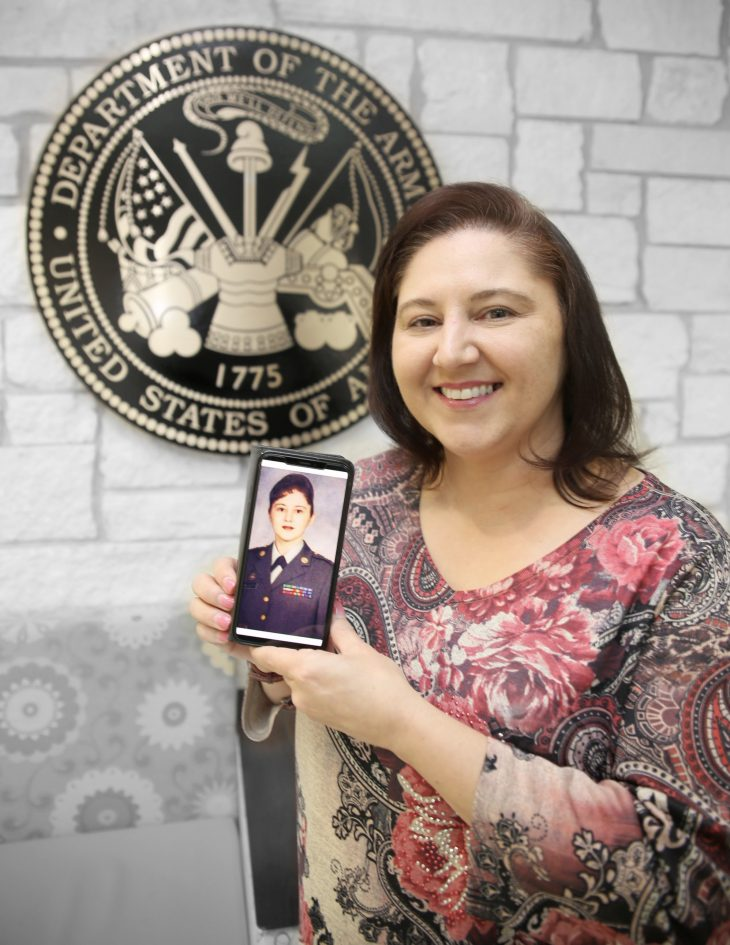 With her smart phone displaying a photo of herself in military uniform in her hands, American military Veteran Karen Walcott poses for a portrait in front of the seal of the U.S. Army located inside the main lobby of the VA's specialty clinic in Corpus Christi, Texas, on February 22, 2019. Walcott was one of 22 women Veterans from the Corpus Christi area who participated in VA Texas Valley Coastal Bend Health Care System's (VCB) 2019 Women Veteran's Portrait Project, which is designed to recognize the service of Women Veterans from the local community during Women's History Month, a nation-wide observance that takes place in March. Walcott served in two branches of the U.S. Armed Forces for a combined total of 15 years. She served as an active-duty member of the Air Force from 1990 to 1996. She worked as a special purpose refueling mechanic and maintenance analyst during her time in the Air Force and earned the rank of staff sergeant (E-5). She then served nine years in the Army Reserve and worked as a personnel services sergeant until the year 2005. (VA photo illustration by Luis H. Loza Gutierrez)