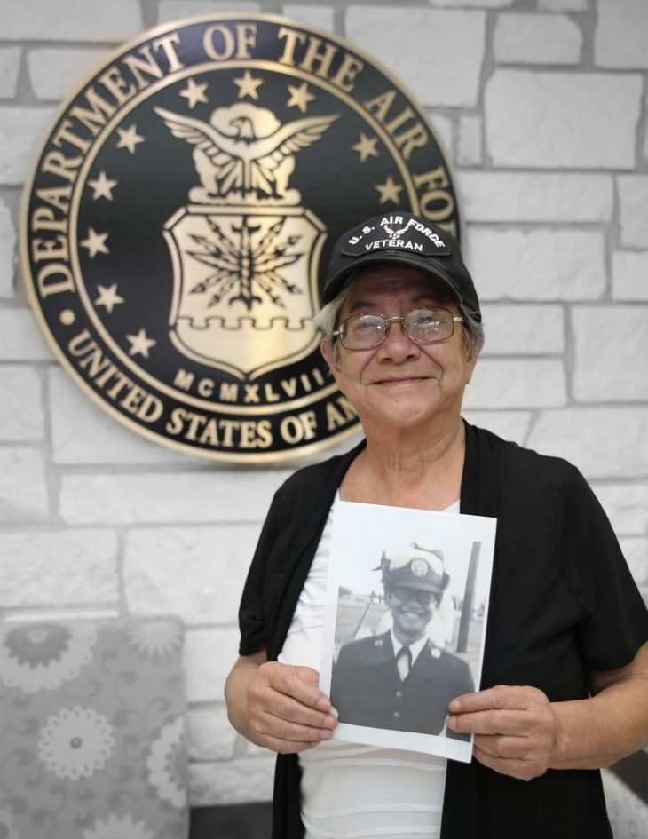 With a photo of herself in military uniform in her hands, American military Veteran Eva Mapp poses for a portrait in front of the seal of the U.S. Air Force, located inside the main lobby of the VA's specialty clinic in Corpus Christi, Texas, on February 21, 2019. Mapp was one of 22 women Veterans from the Corpus Christi area who participated in VA Texas Valley Coastal Bend Health Care System's (VCB) 2019 Women Veteran's Portrait Project, which is designed to recognize the service of Women Veterans from the local community during Women's History Month, a nation-wide observance that takes place in March. Mapp is a Vietnam War-Era Veteran and served six years in the Air Force from 1968 to 1974. She achieved the rank of staff sergeant and worked as a computer operator.  The photo in Mapp's hands was captured after she graduated basic military training in 1968. She then attended technical training at Lowry Air Force Base, Colorado.  (VA photo illustration by Luis H. Loza Gutierrez)