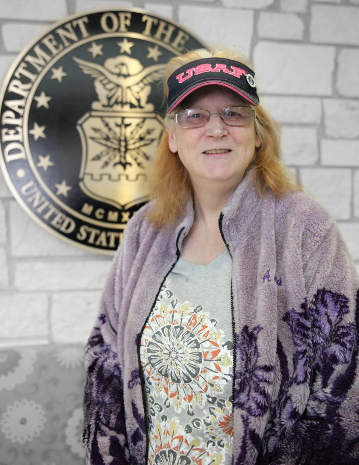 American military Veteran Rox-An Dixon poses for a portrait in front of the seal of the U.S. Air Force, located inside the main lobby of the VA's specialty clinic in Corpus Christi, Texas, on February 21, 2019. Dixon was one of 22 women Veterans from the Corpus Christi area who participated in VA Texas Valley Coastal Bend Health Care System's (VCB) 2019 Women Veteran's Portrait Project, which is designed to recognize the service of Women Veterans from the local community during Women's History Month, a nation-wide observance that takes place in March. Dixon is a Cold War-Era Veteran and served in the Air Force from 1978 to 1983. She achieved the rank of buck sergeant.  She served as a telecommunications operator specialist during her four-and-a-half-year long enlistment.  (VA photo illustration by Luis H. Loza Gutierrez)
