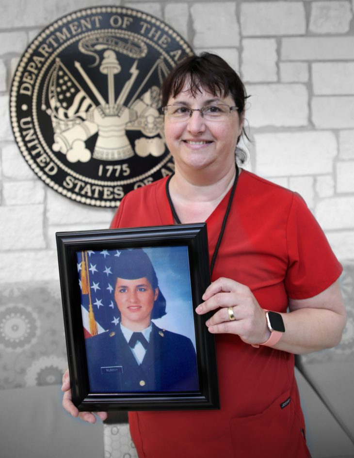 With a framed photo of herself in military uniform in her hands, American military Veteran Silvia C. Murphy poses for a portrait in front of the seal of the U.S. Army located inside the main lobby of the VA's specialty clinic in Corpus Christi, Texas, on February 22, 2019. Murphy was one of 22 women Veterans from the Corpus Christi area who participated in VA Texas Valley Coastal Bend Health Care System's (VCB) 2019 Women Veteran's Portrait Project, which is designed to recognize the service of Women Veterans from the local community during Women's History Month, a nation-wide observance that takes place in March. Murphy served in the Army from 1995 to 1998. She achieved the rank of specialist and worked as an Army medic during her enlistment.  She continues to help serve her fellow Veterans by working as a medical technician for the VA in Corpus Christi. (VA photo illustration by Luis H. Loza Gutierrez)