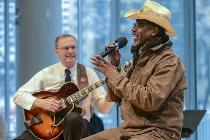 A Veteran sings during a Creative Arts concert
