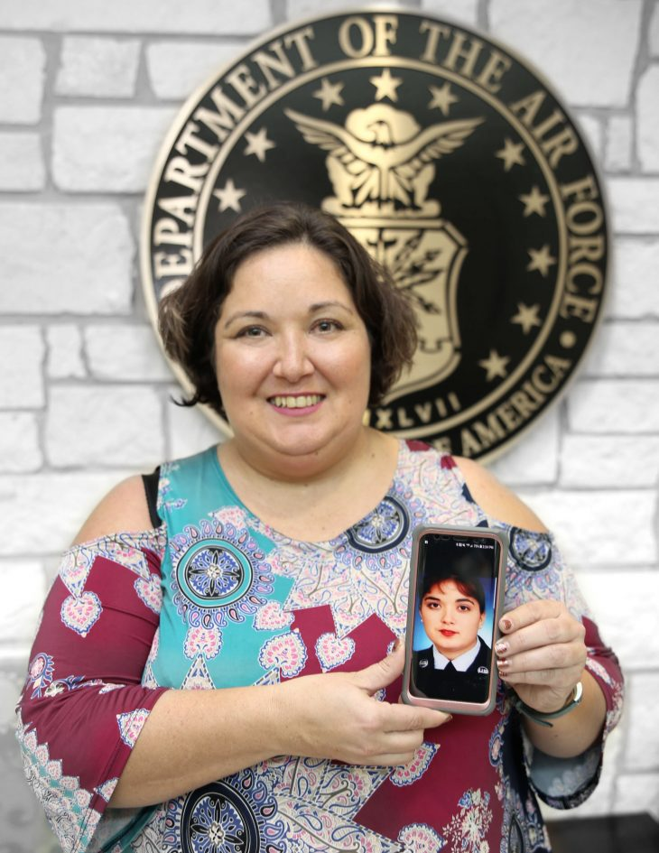 With her smart phone displaying a photo of herself in military uniform in her hands, American military Veteran Dona Marie White poses for a portrait in front of the seal of the U.S. Air Force, located inside the main lobby of the VA's specialty clinic in Corpus Christi, Texas, on February 22, 2019. White was one of 22 women Veterans from the Corpus Christi area who participated in VA Texas Valley Coastal Bend Health Care System's (VCB) 2019 Women Veteran's Portrait Project, which is designed to recognize the service of Women Veterans from the local community during Women's History Month, a nation-wide observance that takes place in March. White retired from the military after serving 20 years in the Air Force from 1994 to 2014. She achieved the rank of staff sergeant and worked as a personnel administration specialist.  White is war Veteran. She deployed in support of Operation Iraqi Freedom and Operation Enduring Freedom. (VA photo by Luis H. Loza Gutierrez)