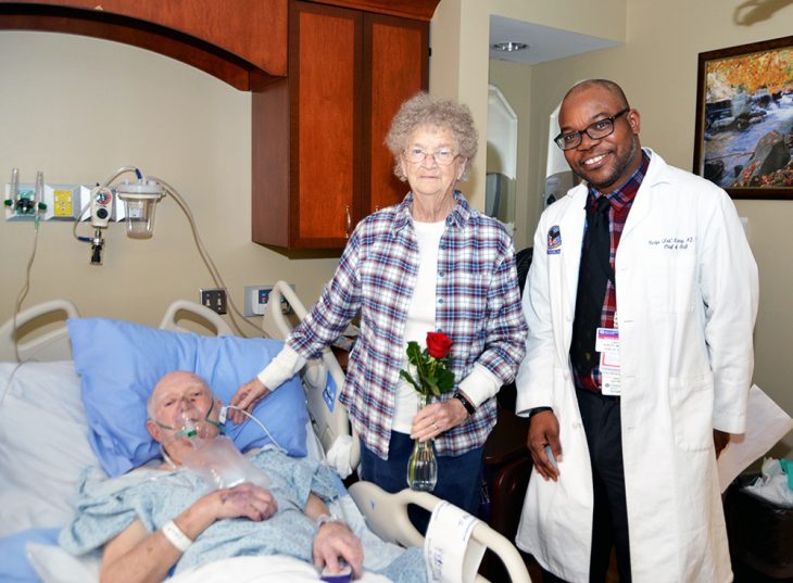 Dr.Oladipo Kukoyi, chief of staff at Birmingham VA Medical Center, delivering roses to a patient and his wife during the National Salute to Veteran Patients