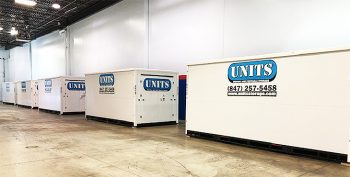 Picture of a warehouse with multiple portable storage units