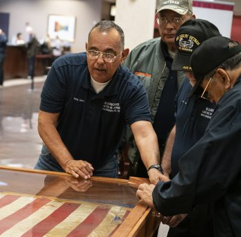 Vietnam War Veterans move the ceremonial flag