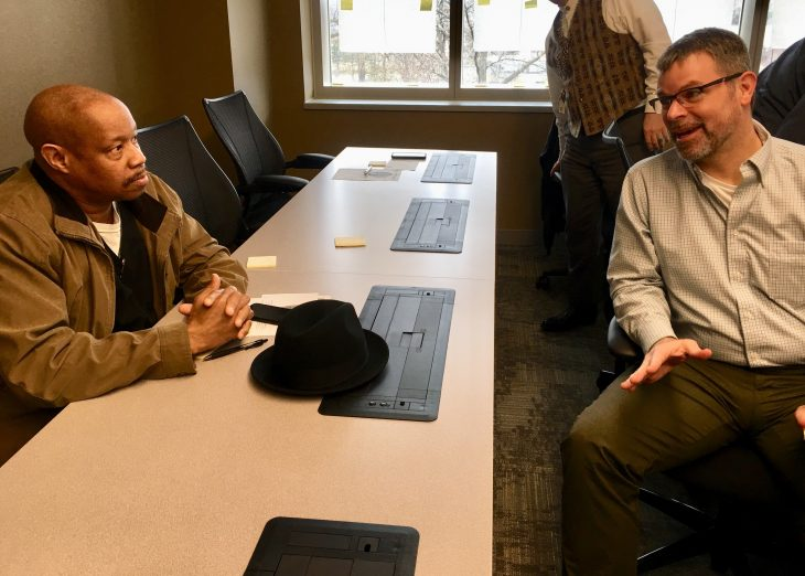 NCA employee and Air Force Veteran Joe Sonderland (on right) discusses the customer experience during the NCA Own the Moment training session.