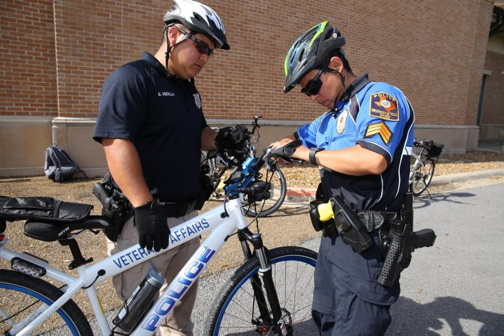 UTRGV Police Sgt. Homar Bahena assists VA Police Officer Erick Medellin with inspection of his bicycle prior to moving on to the last obstacle during a police bicycle training course. Medellin was one of two VA police officers who became the first in VA Texas Valley Coastal Bend Health Care System (VCB)'s history to complete certification for International Police Mountain Bike Association (IMPBA)'s course on February 15, 2019 at an obstacle training course set up bin the rear parking lot of the University of Texas Rio Grande Valley (UTRGV) Academic and Clinical Research Building in Harlingen, Texas. (VA photo by Luis H. Loza Gutierrez)