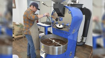Man roasting coffee beans