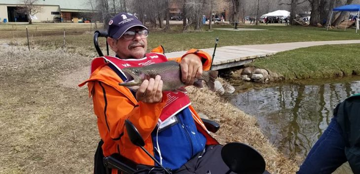 IMAGE of a Veteran holding a trout - Photos of the Week